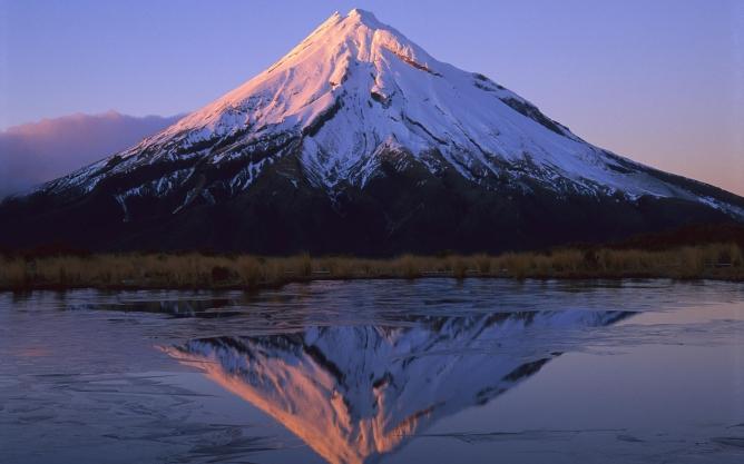 Winter sunrise over Mt. Taranaki from the Pouakai Range, Egmont National Park, New Zealand